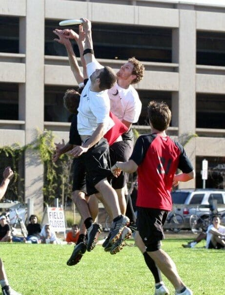 UNC Darkside Ultimate players jumping over defenders to catch the disc.