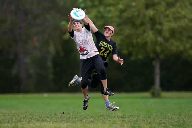 A Capitals player catches the disc with a Brute Squad defender in tight coverage in the Women's finals of Northeast Regionals.